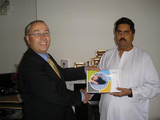 Mr Hussain being presented with his Compact mini by Optelecs Mark Silver